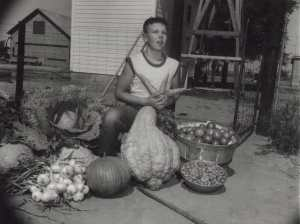 High Plains Museum │ PM1936PEO A young 4-Her from the Smoky Hill Garden 4-H Club shows off the year's vegetable crop, circa 1957.